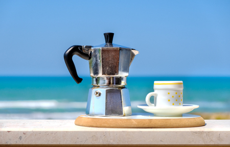 moka pot coffee maker sea background italian breakfast