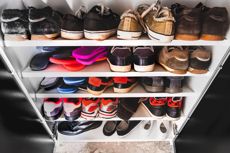 shoe rack man sneakers Stockfoto