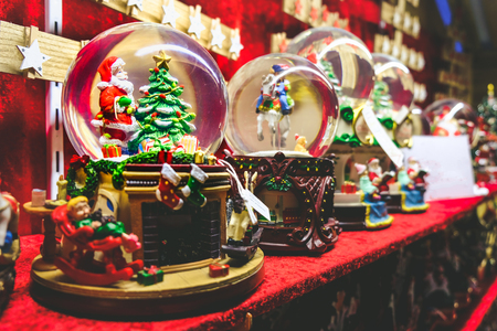 christmas snow globe background crystal ball with santa claus and christmas tree inside Stock Photo