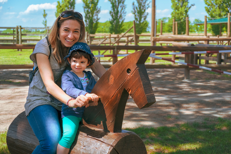 happy family horse ranch petting zoo trip background mother and baby child ride 版權商用圖片