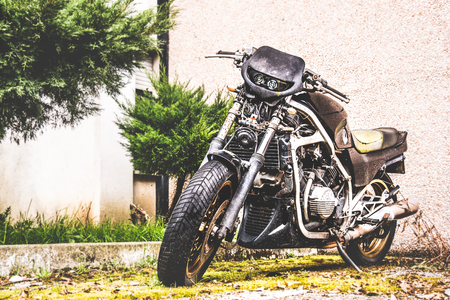 black motorcycle parked urban background Stock Photo