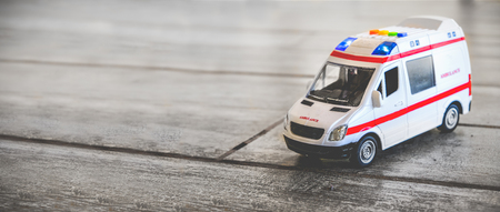ambulance horizontal background health care toy sirens blue lights copy space Stock Photo