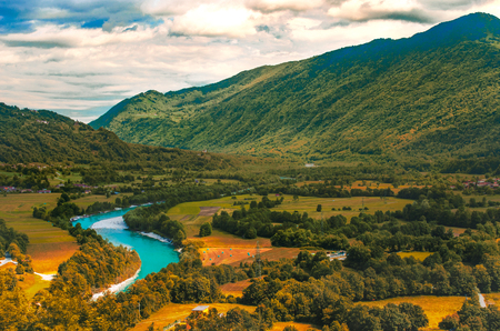 Isonzo Soca river valley  yellow teal and orange sunset landscape in  Slovenia - Italy border Imagens