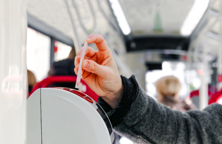bus ticket insert validator  hand background