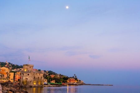 panorama italian sea village space text and moon high in the sky - Rapallo italy sea town copy space background night sunset