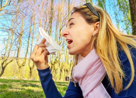 sneeze allergic hay fever pollen allergy blowing nose springtime