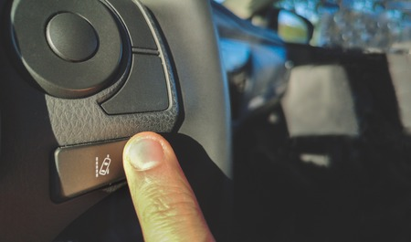 lane change assist system  button on the steering wheel of car