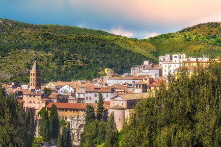 panoramic italian town of Tivoli near Rome in Lazio surrounded by a lush forest Banco de Imagens