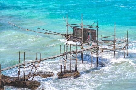 Trabocchi coast of Punta Aderci in Vasto - Abruzzo region - Chieti province- trabucco or trabocco is old wooden palatiffe stilt house shack fishing machine south italy sea Stock Photo