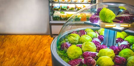 vegetable market refrigerator lettuce salad at supermarket horizontal background Banco de Imagens