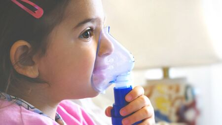 childhood asthma inhaling mask illnesses little baby girl with flu id doing aerosol independently