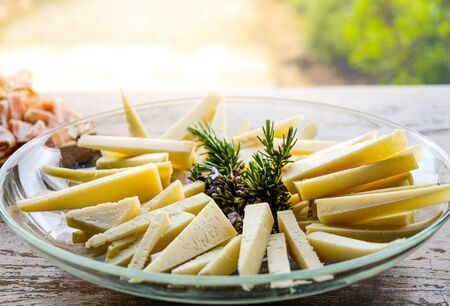cheese wedges on a plate slices of pecorino