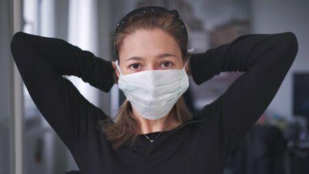 horizontal background of woman wearing surgical mask for corona virus isolation