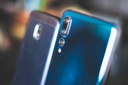 phone camera comparison background close up .
