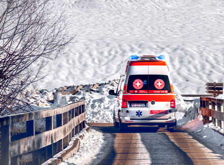 snow emergency ambulance with in winter snow background road