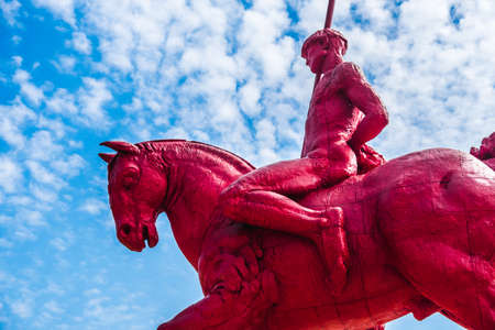 red knight and horse with sky background at the Masone Labyrinth Museum in Fontanellato - Parma - Italy
