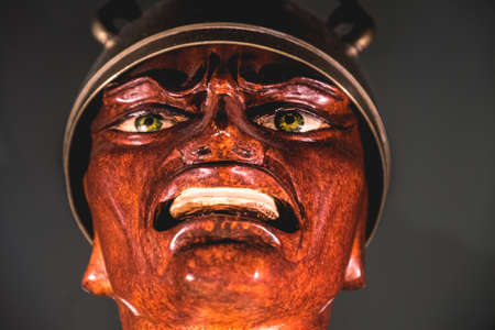 evil soldier face statue at the Masone Labyrinth Art Museum of Fontanellato in province of Parma , Italy