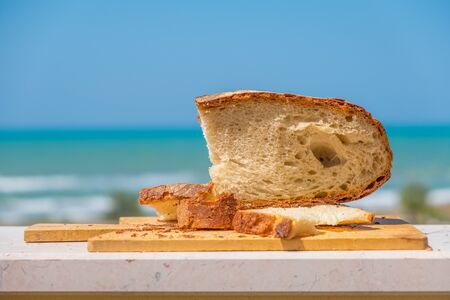 bakery shop background with Pane Pugliese, a traditional bread of South Italy food tradition Imagens