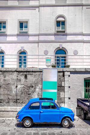 vintage car vertical background in italy village selective color