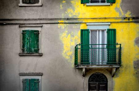 yellow splash color building background yellow plaster paint italian homes background Фото со стока