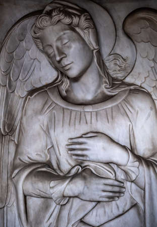 funerary art background of an sleeping angel in the Certosa cemetery Редакционное