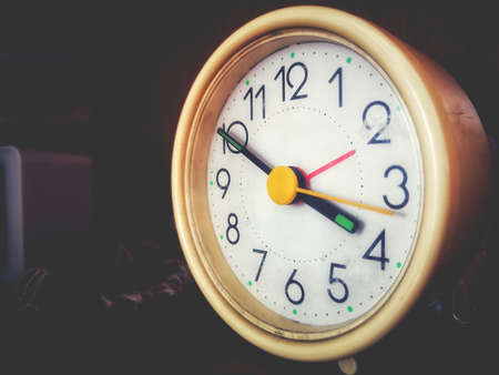 alarm clock - A vintage alarmclock in a faded background with copy space Фото со стока