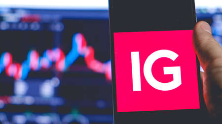 IG Trading app smartphone equities rates trader broker work in stock exchange market