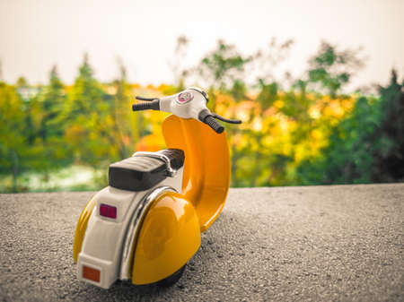 background with old toy scooter in vintage Italian style
