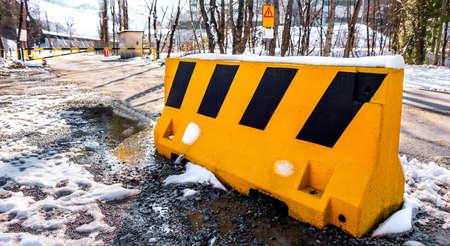 guard rail bollard on blocked read due to bad weather snow winter horizontal background Foto de archivo