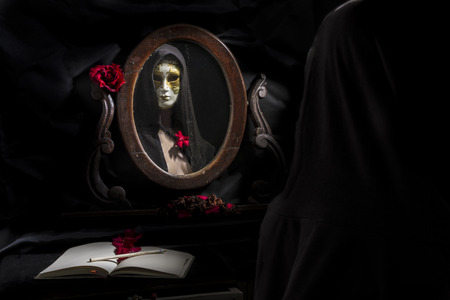 reflection of masked woman in the mirror