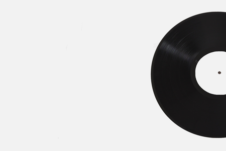 Black vinyl record with white label on white background