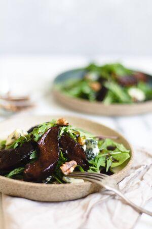 Pear salad with balsamic vinegar nuts and arugula.