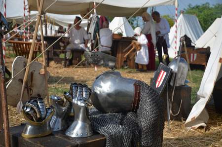 chivalry: medieval reenactment showing life in a camp with armor