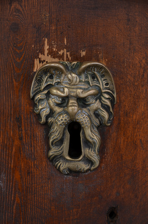 old sculpted brass keyhole photo