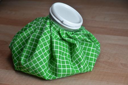 green ice bag on wood table photo