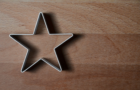 star shaped: star shaped food ring mold on a wood table