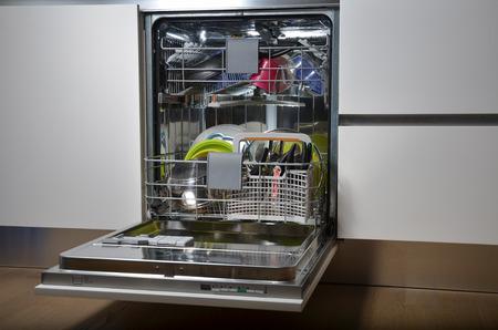 opened dishwasher full of dishes photo