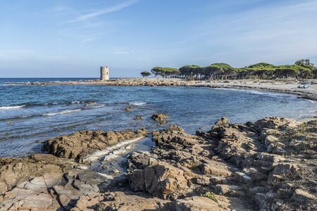 A beautiful beach in La Caletta with an ancient tower