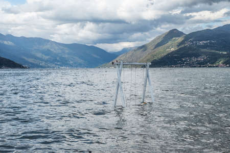 Swing submerged by Lake Maggiore in flood in Germignaga
