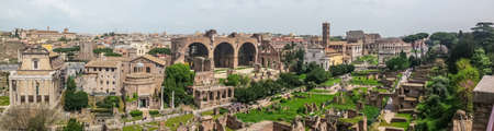 Ultra wide view of the ancient Roman Forum and the Colosseum in background in Rome