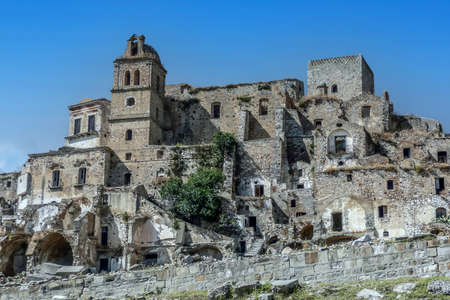 landscape of the ghost town of Craco, with abandoned houses in ruins due to a landslide