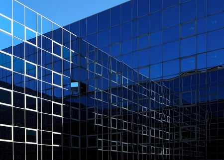 reflect: Two modern glass facades that intersect and reflect themselves