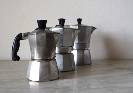 Three moka, the traditional Italian coffee maker, of different sizes to prepare one, two or three coffee cups