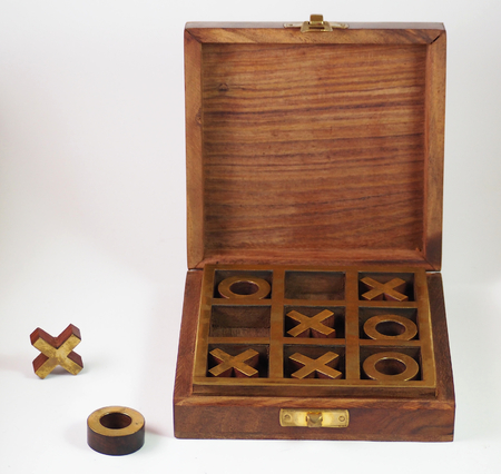 The game of tic tac toe in its wooden box