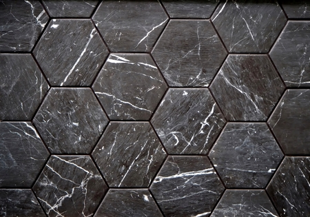 Wall or floor tiles made of black stone with white streaks. Used for interiors, mainly bathrooms