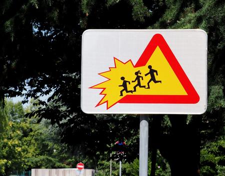 School children crossing zone, caution. Warning sign.