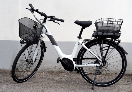 Brand new electric bicycle, or and bike, for women. The new battery is thin enough to be placed under the back basket