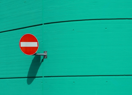 No entry red traffic sign on emerald wall background
