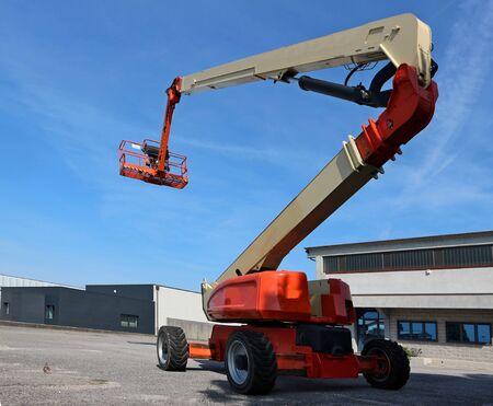 Aerial work platform in an industrial area. No people.