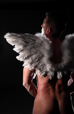 nude muscular man with wings photo